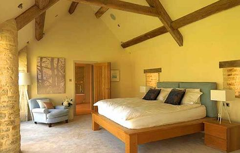 yellow-bedroom-walls-and-beams
